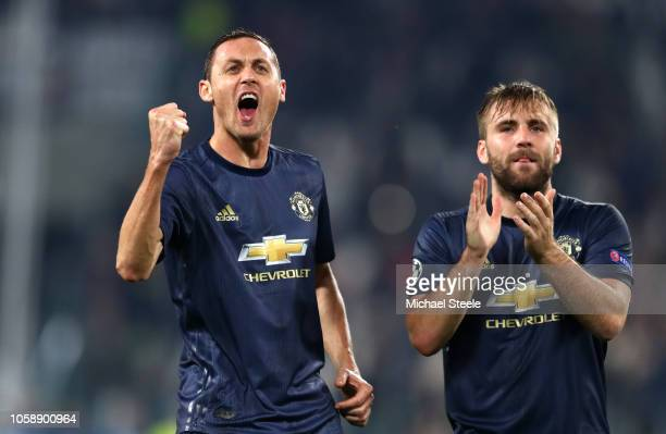 Nemanja Matic of Manchester United and Luke Shaw of Manchester United celebrate at the end of the match after the UEFA Champions League Group H match...
