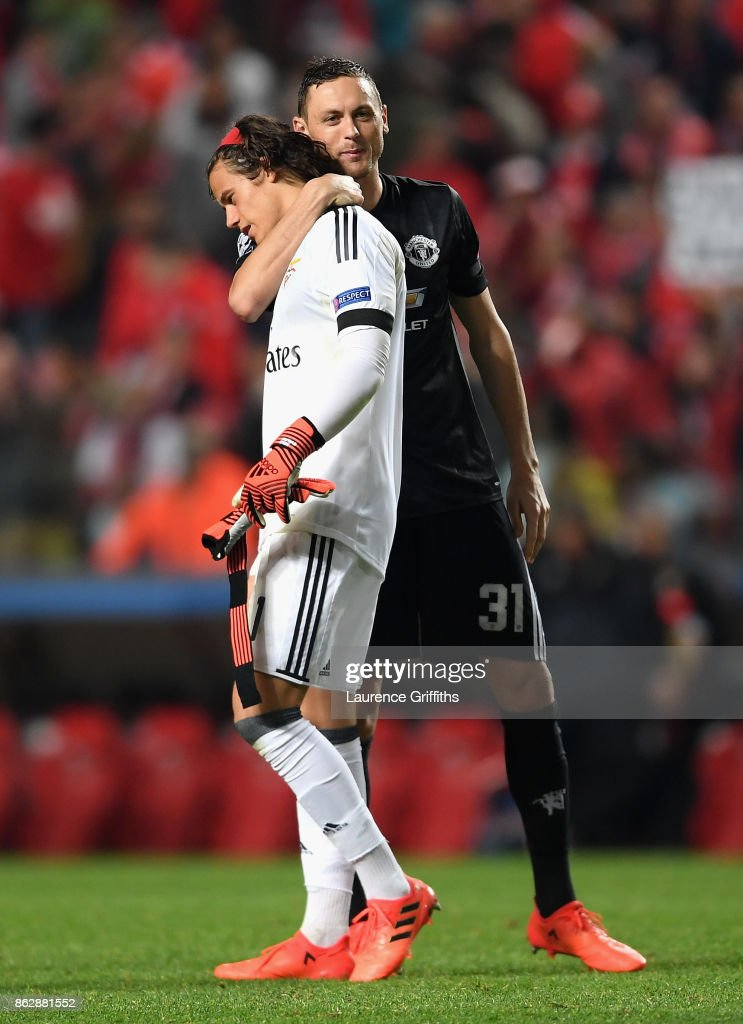 Nemanja Matic of Manchester United and Mile Svilar of Benfica embrace after the UEFA Champions League group A match between SL Benfica and Manchester United at Estadio da Luz on October 18, 2017 in Lisbon, Portugal.