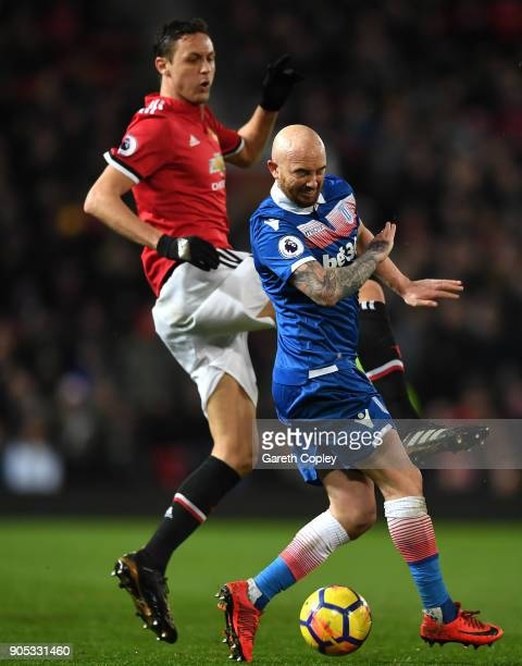 Nemanja Matic of Manchester United and Stephen Ireland of Stoke City battle for the ball during the Premier League match between Manchester United...
