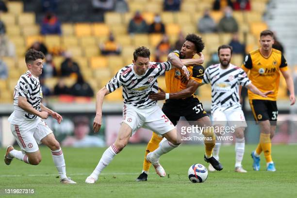 Nemanja Matic of Manchester United battles for possession with Adama Traore of Wolverhampton Wanderers during the Premier League match between...