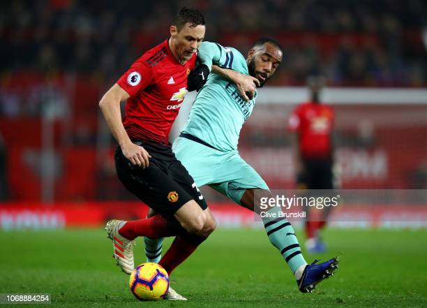 Nemanja Matic of Manchester United battles for possession with Alexandre Lacazette of Arsenal during the Premier League match between Manchester...