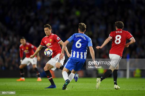 Nemanja Matic of Manchester United battles for the ball with Dale Stephens of Brighton Hove Albion during the Premier League match between Brighton...