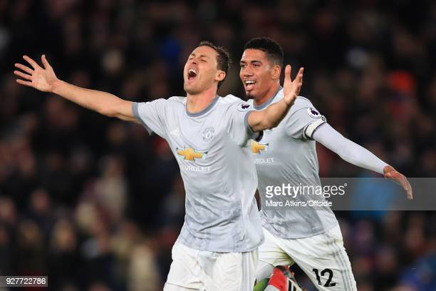 Nemanja Matic of Manchester United celebrates his late winning goal with Chris Smalling during the Premier League match between Crystal Palace and...