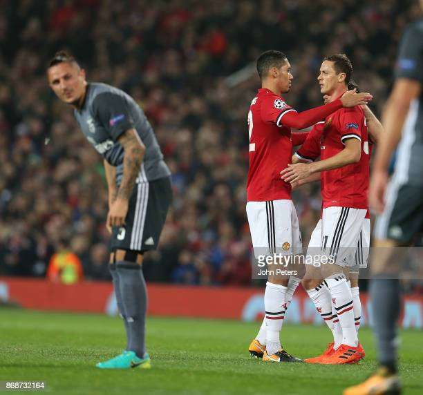 Nemanja Matic of Manchester United celebrates his part in Mile Svilar of Benfica scoring an own goal during the UEFA Champions League group A match...