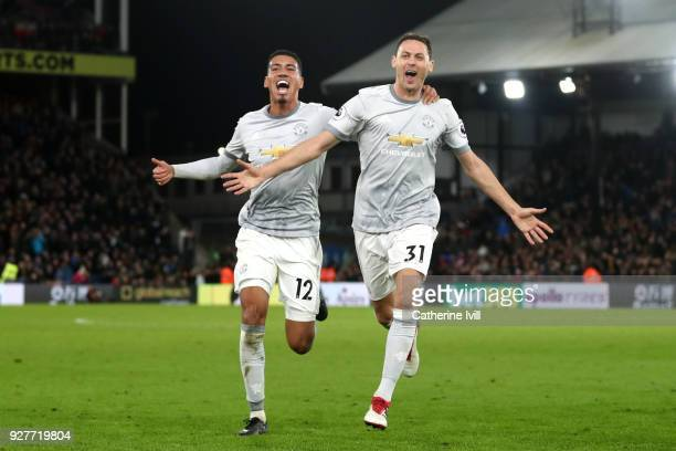 Nemanja Matic of Manchester United celebrates scoring the third Manchester United goal with Chris Smalling during the Premier League match between...