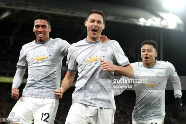Nemanja Matic of Manchester United celebrates scoring the third Manchester United goal with Chris Smalling and Jesse Lingard during the Premier...