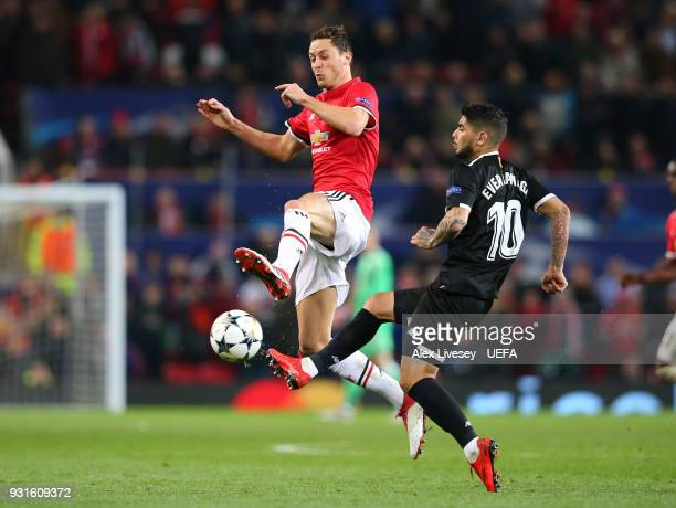 Nemanja Matic of Manchester United challenges Ever Banega of Sevilla FC during the UEFA Champions League Round of 16 Second Leg match between...