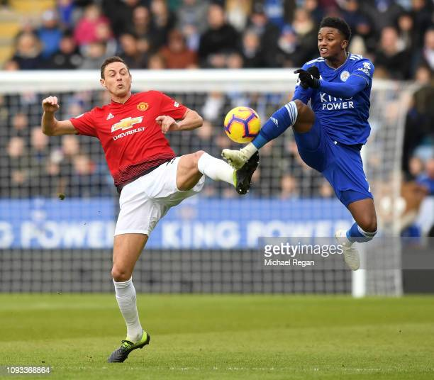 Nemanja Matic of Manchester United challenges for the ball with Demarai Gray of Leicester City during the Premier League match between Leicester City...
