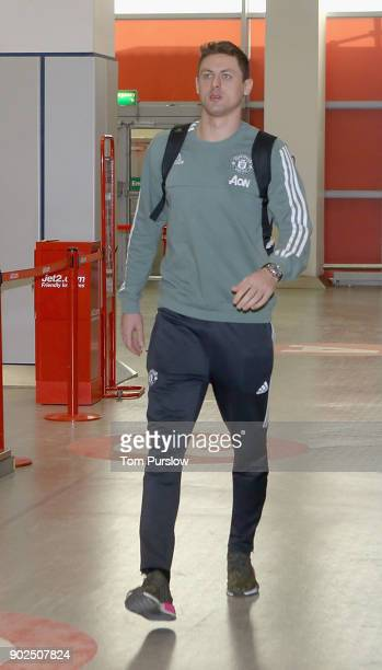 Nemanja Matic of Manchester United checks in ahead of a flight to Dubai for a warmweather training camp at Manchester Airport on January 8 2018 in...