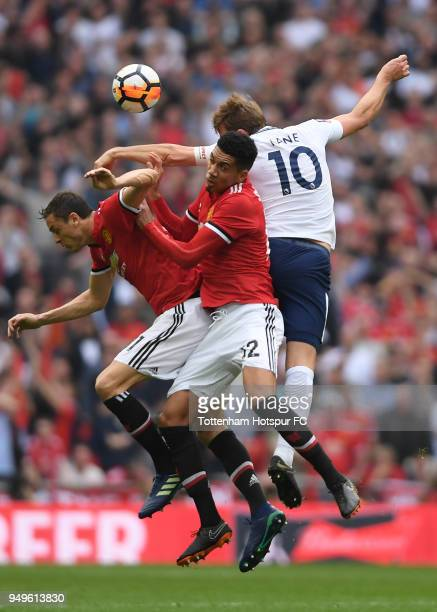 Nemanja Matic of Manchester United Chris Smalling of Manchester United and Harry Kane of Tottenham Hotspur compete for a header during The Emirates...