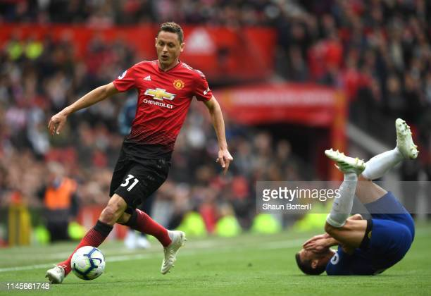 Nemanja Matic of Manchester United clashes with Cesar Azpilicueta of Chelsea as he wins the ball during the Premier League match between Manchester...