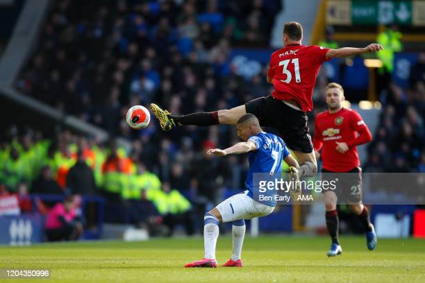 Nemanja Matic of Manchester United clears the ball away from Richarlison of Everton FC during the Premier League match between Everton FC and...