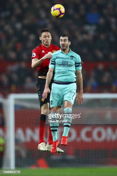 Nemanja Matic of Manchester United competes for a header with Henrikh Mkhitaryan of Arsenal during the Premier League match between Manchester United...