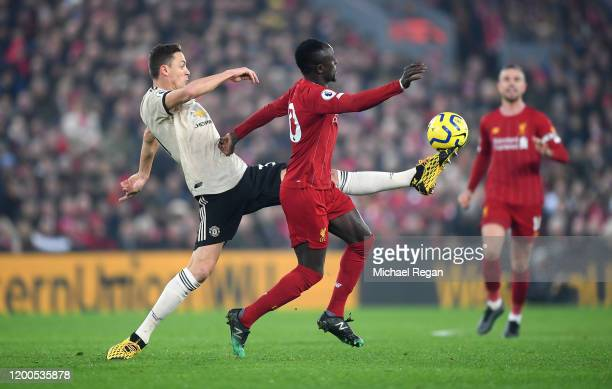 Nemanja Matic of Manchester United controls the ball while under pressure from Sadio Mane of Liverpool during the Premier League match between...