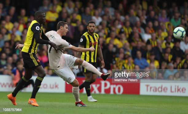 Nemanja Matic of Manchester United in action with Abdoulaye Doucoure of Watford during the Premier League match between Watford FC and Manchester...