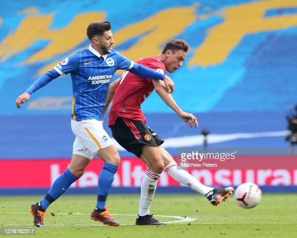 Nemanja Matic of Manchester United in action with Adam Lallana of Brighton and Hove Albion during the Premier League match between Brighton Hove...