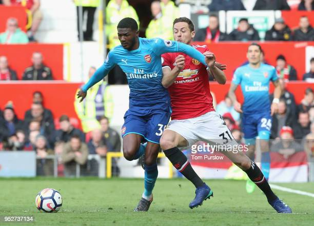 Nemanja Matic of Manchester United in action with Ainsley MaitlandNiles of Arsenal during the Premier League match between Manchester United and...