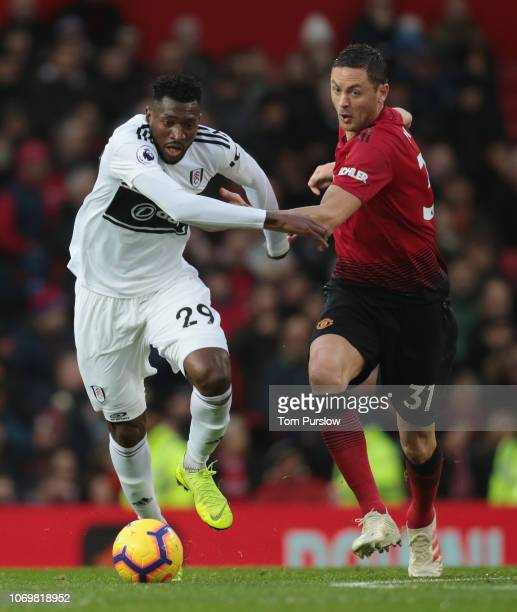 Nemanja Matic of Manchester United in action with AndreFrank Zambo Anguissa of Fulham during the Premier League match between Manchester United and...