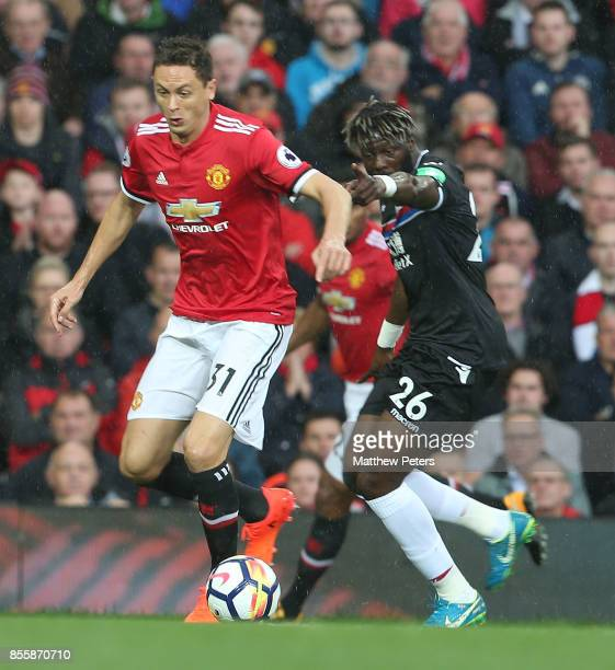 Nemanja Matic of Manchester United in action with Bakary Sako of Crystal Palace during the Premier League match between Manchester United and Crystal...