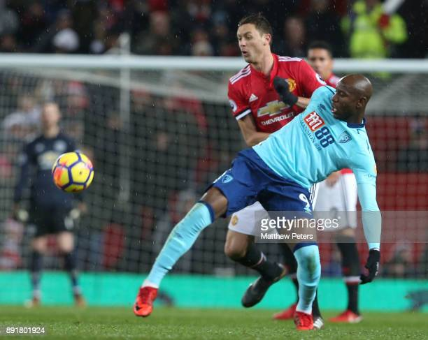 Nemanja Matic of Manchester United in action with Benik Afobe of AFC Bournemouth during the Premier League match between Manchester United and AFC...
