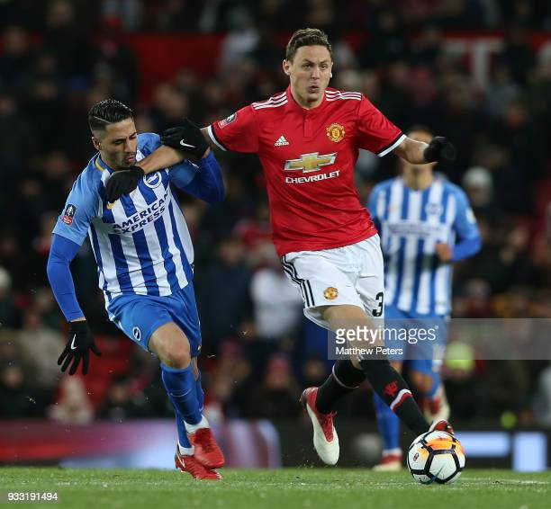 Nemanja Matic of Manchester United in action with Beram Kayal of Brighton Hove Albion during the Emirates FA Cup Quarter Final match between...
