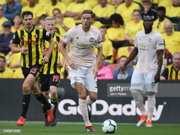 Nemanja Matic of Manchester United in action with Craig Cathcart of Watford during the Premier League match between Watford FC and Manchester United...