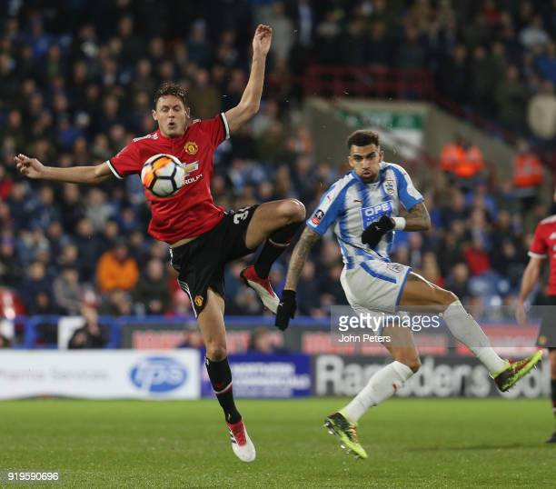 Nemanja Matic of Manchester United in action with Danny Williams of Huddersfield Town during the Emirates FA Cup Fifth Round match between...