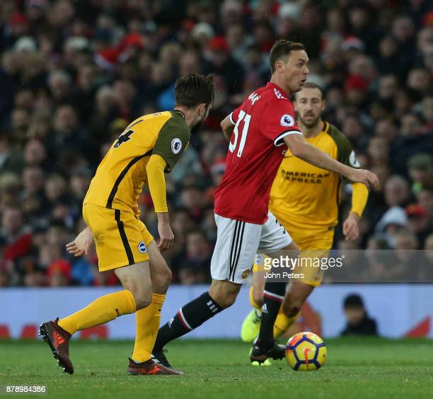 Nemanja Matic of Manchester United in action with Davy Propper of Brighton and Hove Albion during the Premier League match between Manchester United...