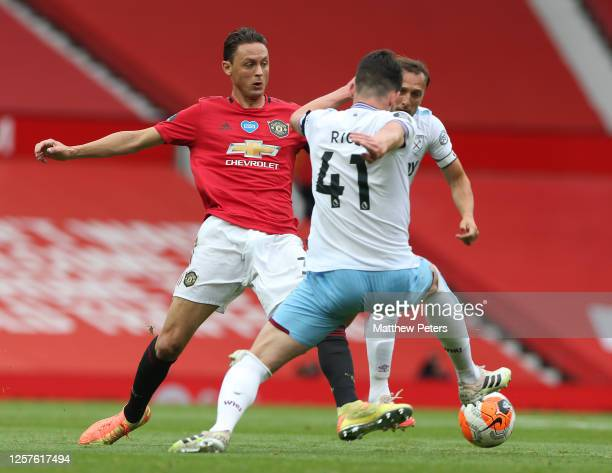 Nemanja Matic of Manchester United in action with Declan Rice of West Ham United during the Premier League match between Manchester United and West...
