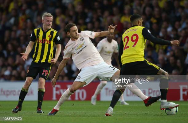 Nemanja Matic of Manchester United in action with Etienne Capoue of Watford during the Premier League match between Watford FC and Manchester United...