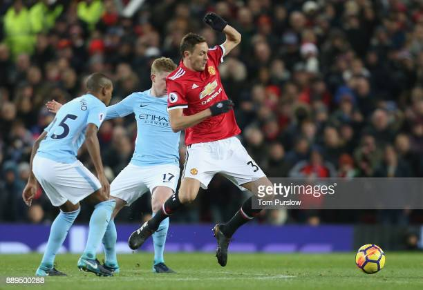 Nemanja Matic of Manchester United in action with Fernandinho and Kevin de Bruyne of Manchester City during the Premier League match between...