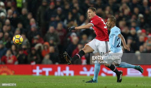 Nemanja Matic of Manchester United in action with Fernandinho of Manchester City during the Premier League match between Manchester United and...