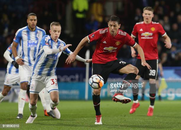 Nemanja Matic of Manchester United in action with Florent Hadergjonaj of Huddersfield Town during the Emirates FA Cup Fifth Round match between...