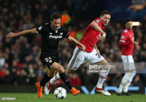 Nemanja Matic of Manchester United in action with Franco Vazquez of Sevilla FC during the UEFA Champions League Round of 16 Second Leg match between...