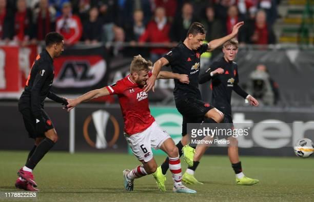 Nemanja Matic of Manchester United in action with Fredrik Midtsjo of AZ Alkmaar during the UEFA Europa League group L match between AZ Alkmaar and...