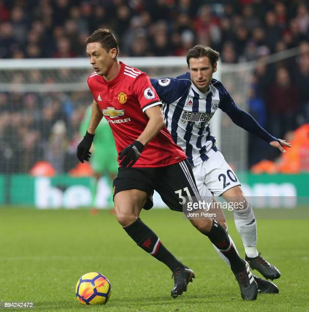 Nemanja Matic of Manchester United in action with Grzegorz Krychowiak of West Bromwich Albion during the Premier League match between West Bromwich...