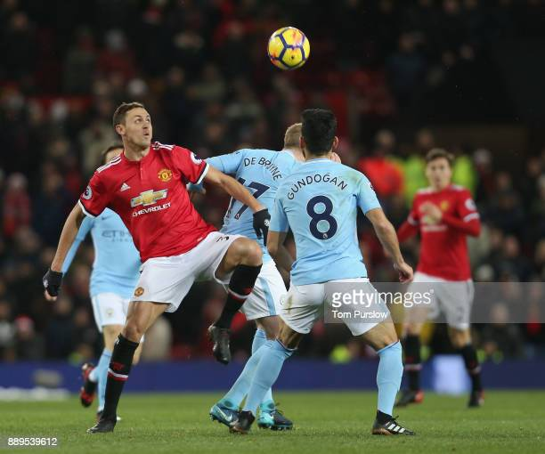Nemanja Matic of Manchester United in action with Ilkay Gundogan of Manchester City during the Premier League match between Manchester United and...