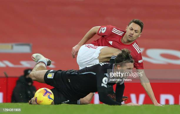 Nemanja Matic of Manchester United in action with Jack Grealish of Aston Villa during the Premier League match between Manchester United and Aston...