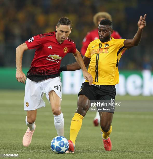 Nemanja Matic of Manchester United in action with JeanPierre Nsame of BSC Young Boys during the Group H match of the UEFA Champions League between...