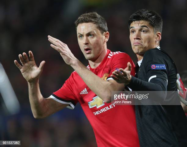 Nemanja Matic of Manchester United in action with Joaquin Correa of Sevilla FC during the UEFA Champions League Round of 16 Second Leg match between...