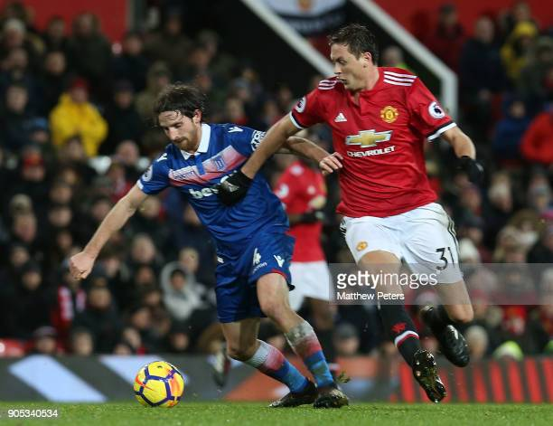 Nemanja Matic of Manchester United in action with Joe Allen of Stoke City during the Premier League match between Manchester United and Stoke City at...