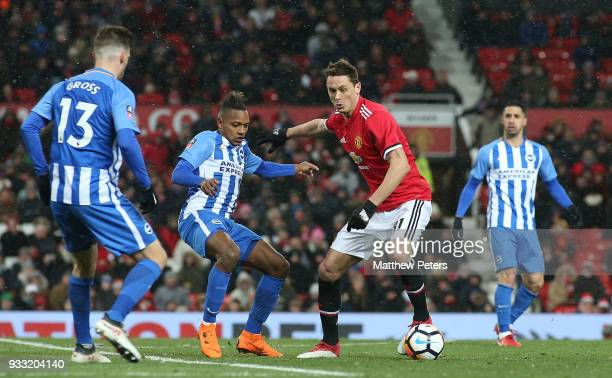 Nemanja Matic of Manchester United in action with Jose Izquierdo of Brighton Hove Albion during the Emirates FA Cup Quarter Final match between...