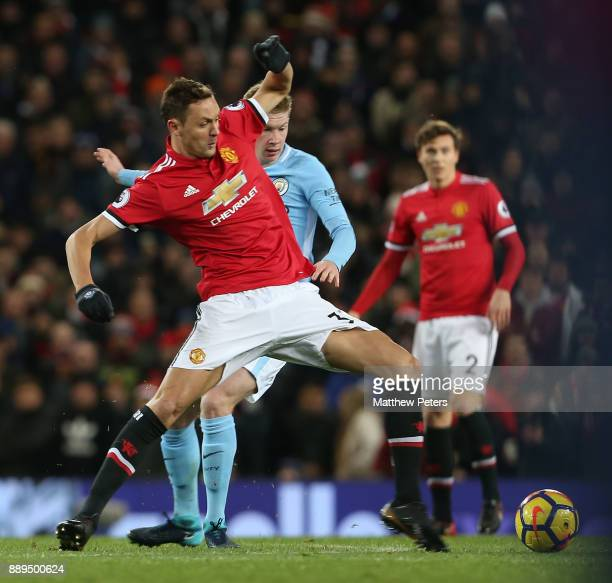 Nemanja Matic of Manchester United in action with Kevin de Bruyne of Manchester City during the Premier League match between Manchester United and...