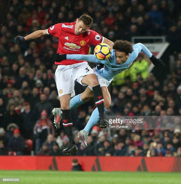 Nemanja Matic of Manchester United in action with Leroy Sane of Manchester City during the Premier League match between Manchester United and...