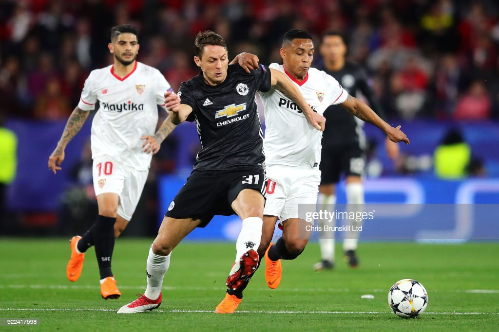 Nemanja Matic of Manchester United in action with Luis Muriel of Sevilla FC during the UEFA Champions League Round of 16 First Leg match between Sevilla FC and Manchester United at Estadio Ramon Sanchez Pizjuan on February 21, 2018 in Seville, Spain.