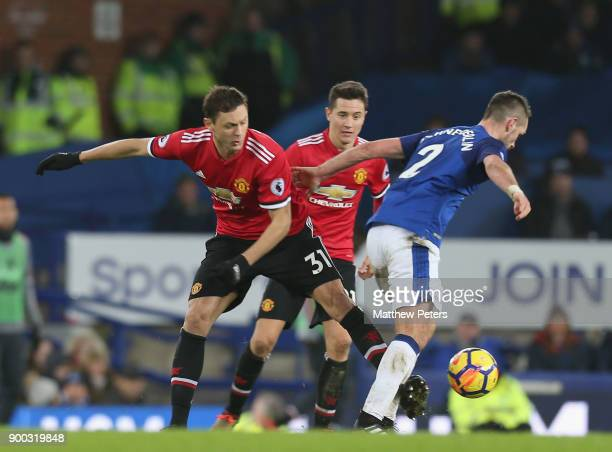 Nemanja Matic of Manchester United in action with Morgan Schneiderin of Everton during the Premier League match between Everton and Manchester United...