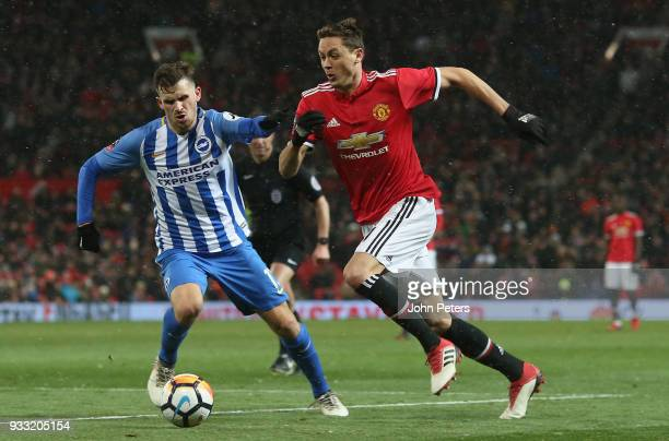 Nemanja Matic of Manchester United in action with Pascal Gross of Brighton Hove Albion during the Emirates FA Cup Quarter Final match between...