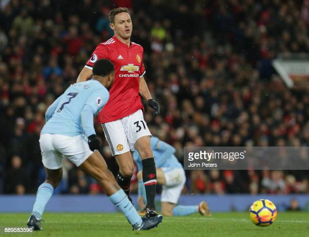 Nemanja Matic of Manchester United in action with Raheem Sterling of Manchester City during the Premier League match between Manchester United and...