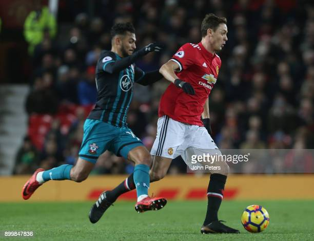 Nemanja Matic of Manchester United in action with Sofiane Boufal of Southampton during the Premier League match between Manchester United and...