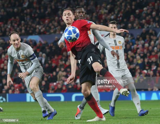 Nemanja Matic of Manchester United in action with Steve von Bergen of BSC Young Boys during the Group H match of the UEFA Champions League between...